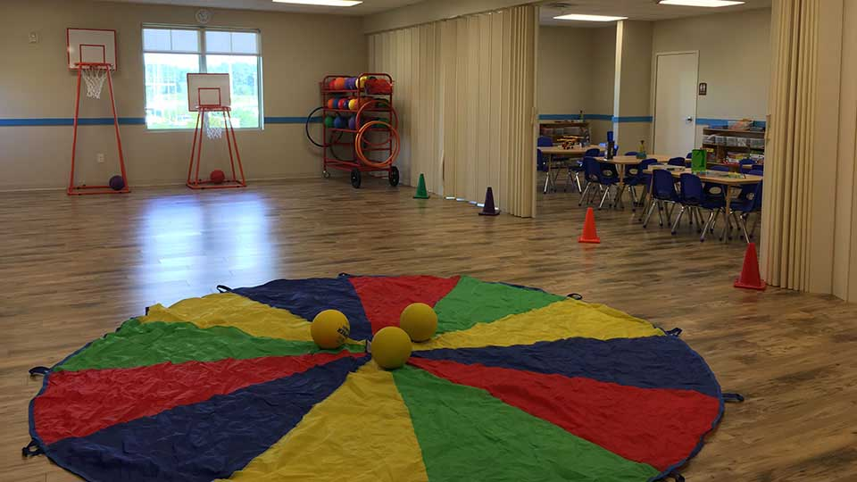 Folding partition, indoor play area, preschool playroom, bruce flooring, daycare design, day care center design, childcare design, child care design, child care centre design, child care interior design, child care architect