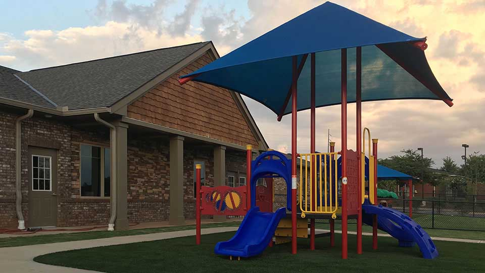 Cedar shakes, Kaplan playground equipment, playground shade canopy, covered patio, daycare design, day care center design, childcare design, child care design, child care centre design, child care interior design, child care architect