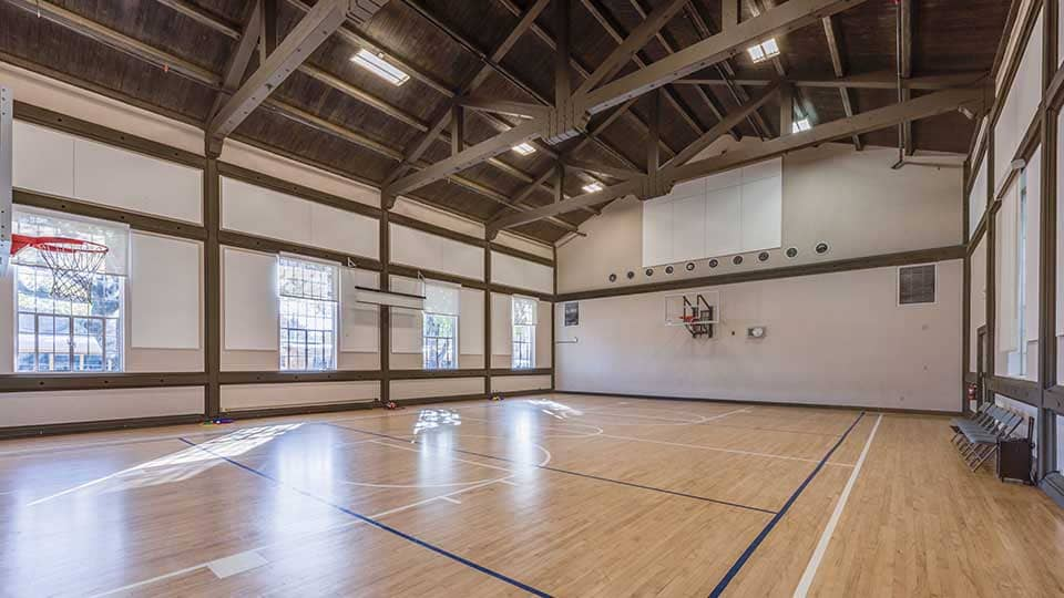 Wood beam ceiling, indoor gym, school design, school building design, design of school building