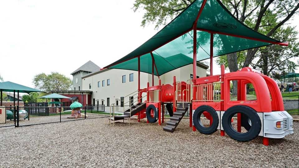 Tot tree, Sunport Shade, playground mulch, little tikes fire truck, daycare design, day care center design, childcare design, child care design, child care centre design, child care interior design, child care architect