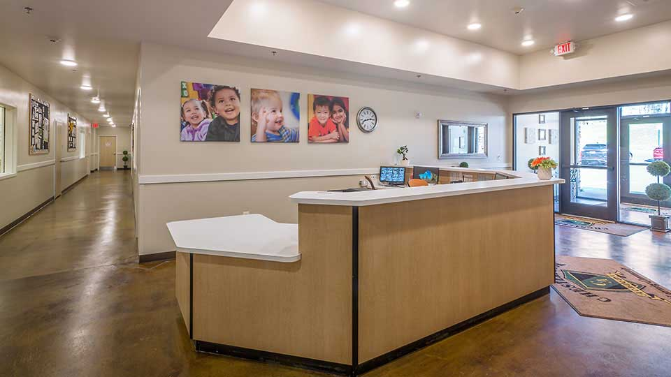 Reception desk, daycare lobby, concrete stain, daycare design, day care center design, childcare design, child care design, child care centre design, child care interior design, child care architect